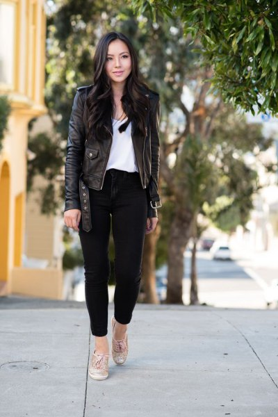 black leather jacket with ankle jeans and white scoop neck blouse
