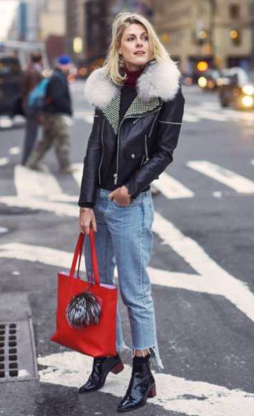 black leather jacket with cropped boyfriend jeans and ankle boots