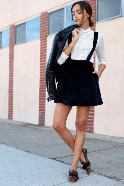 black leather jacket with white shirt and suspender skater skirt