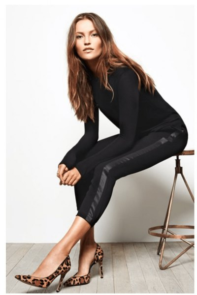 black long sleeve form fitting sweater with cropped pants and snake printed heels