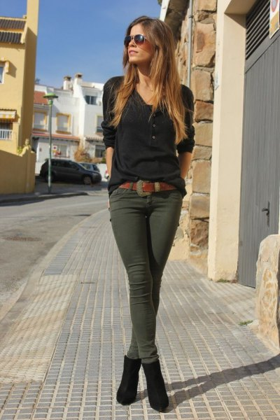 black long sleeve t shirt with green skinny pants and ankle boots
