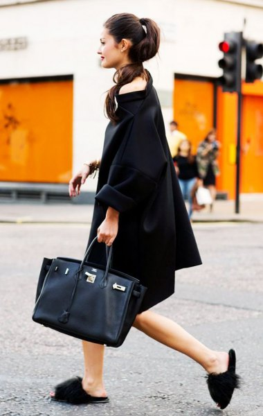 black midi boat neck shift dress with slippers and black leather purse