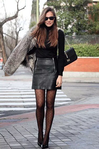 black mock neck sweater with mini high rise faux leather skirt