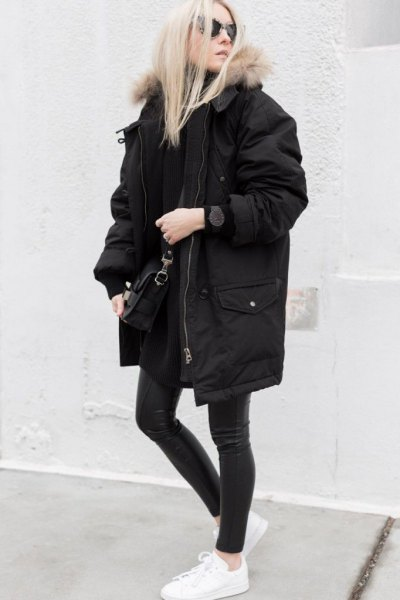 black oversized parka jacket with matching skinny jeans