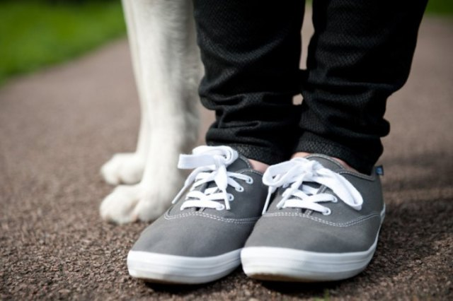 black slim fit jeans with grey and white walking sneakers