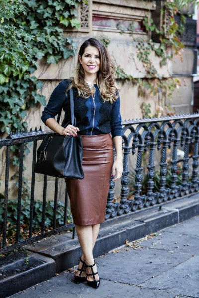 black zip up jacket with brown faux leather midi skirt