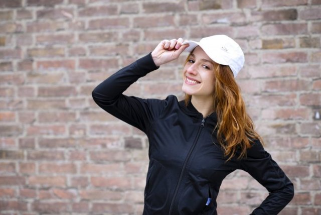 black zip up sweatshirt with white bush hat