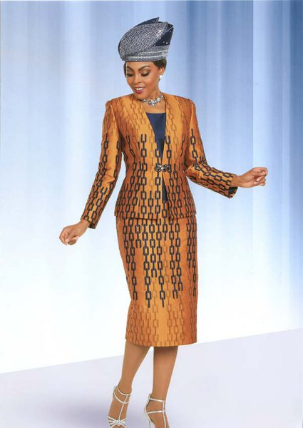 gold and black printed church suit with white strappy heels
