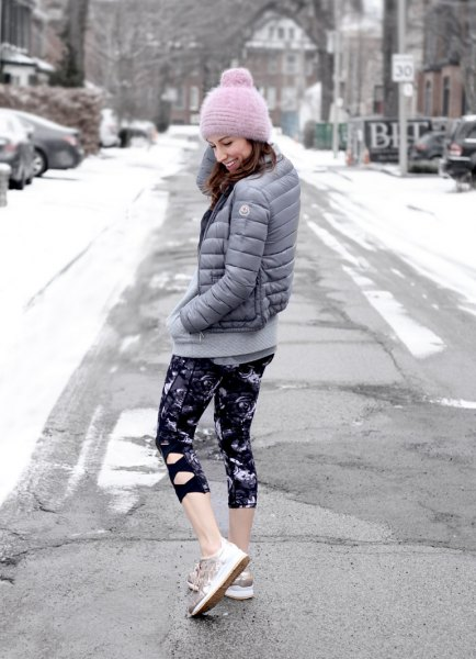 grey down jacket with black and white printed skinny cropped leggings