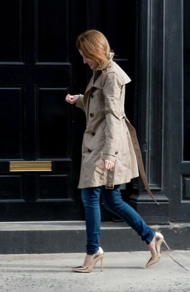 grey longline parka jacket with dark skinny jeans and gold heels