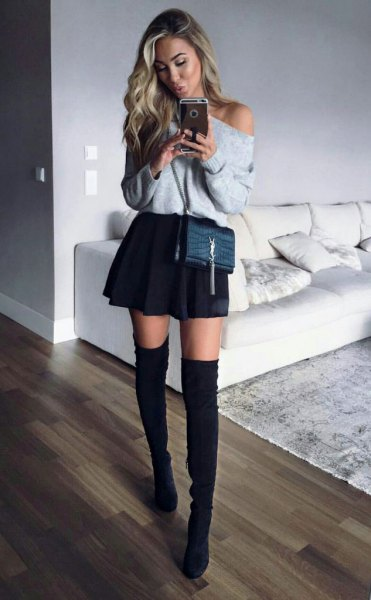 grey off the shoulder sweater with black mini skater skirt