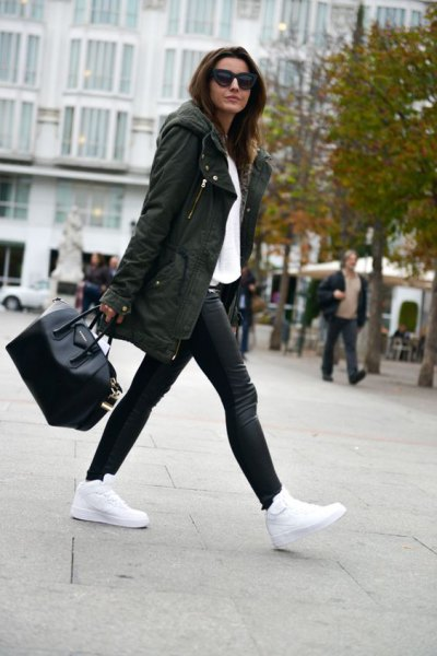 hooded longline parka jacket with white blouse and leather leggings