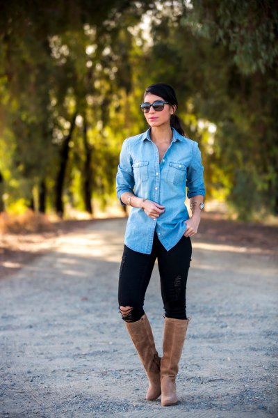 light blue chambray button up shirt with black jeans and grey suede flat knee high boots