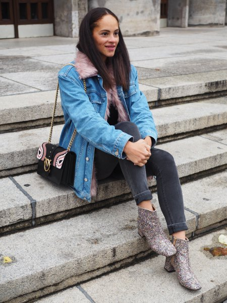 light blue denim jacket with grey skinny jeans and printed boots