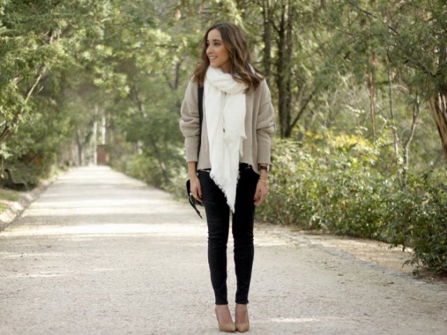 light grey sweater with white scarf and black skinny jeans
