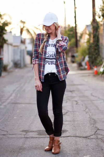 pink and navy blue plaid shirt with white baseball cap