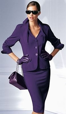 purple skirt suit with black leather purse