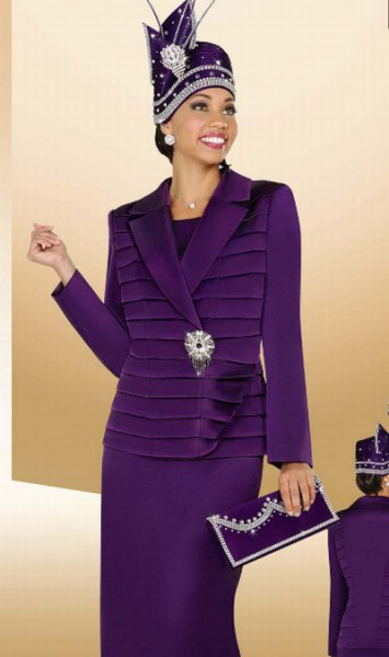 purple suit jacket with midi skirt and clutch bag