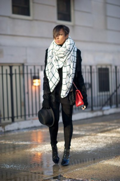 white and black plaid blanket scarf with leather jacket