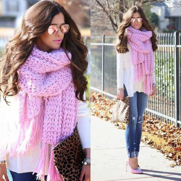 white blouse with light pink knit fringe scarf and blue cuffed jeans
