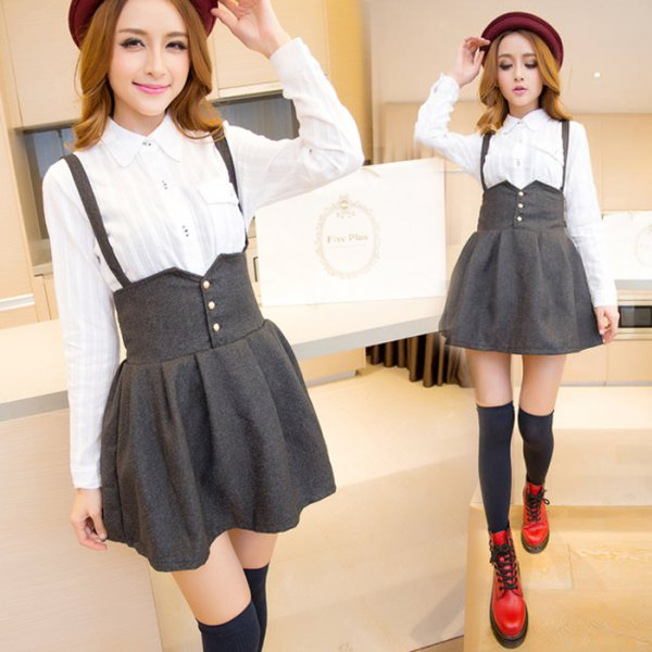 white button up shirt with grey high rise mini suspender skirt