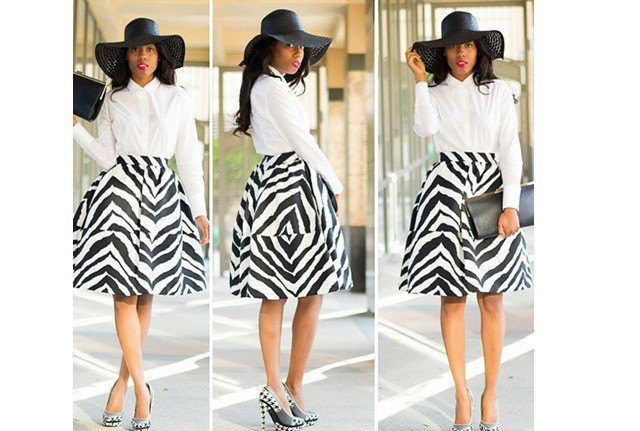white button up shirt with zebra printed flared midi skirt and floppy church hat