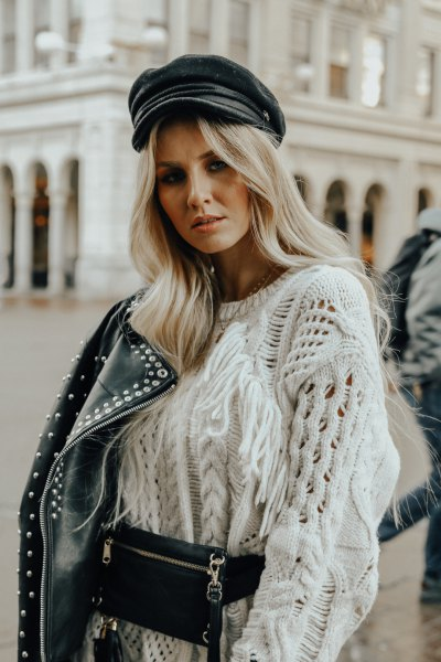 white cable knit chunky sweater with studded moto jacket and leather painters hat