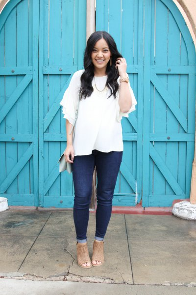 white half sleeve blouse with dark jeans and open toe boots
