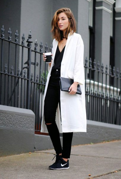 white maxi blazer with v neck top and black walking shoes