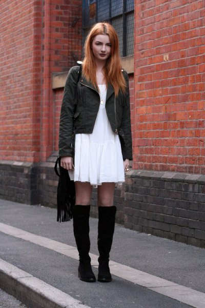white mini shift dress with black jacket and boots
