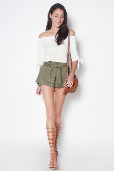 white off the shoulder half sleeve cropped blouse with green tie shorts