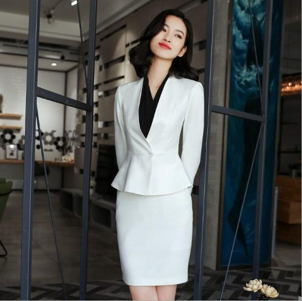 white peplum suit jacket with mini skirt and black blouse
