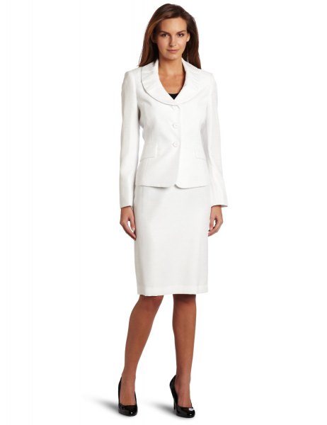 white suite jacket with knee length straight cut dress and black heels