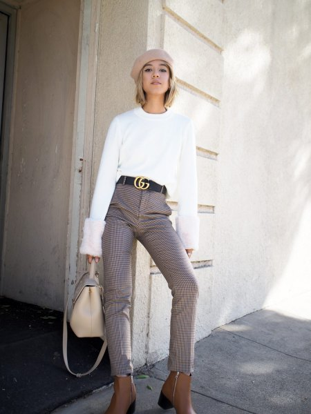 white sweater with pale pink painters hat and statement belt