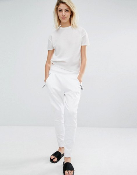 white t shirt with matching pants and black slide sandals