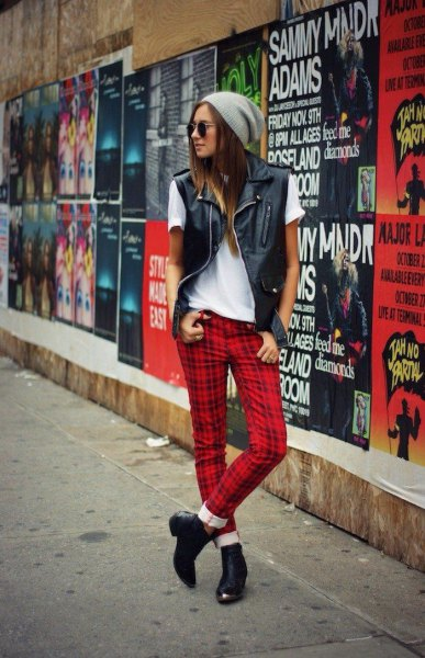white tee with black leather vest and red plaid pants