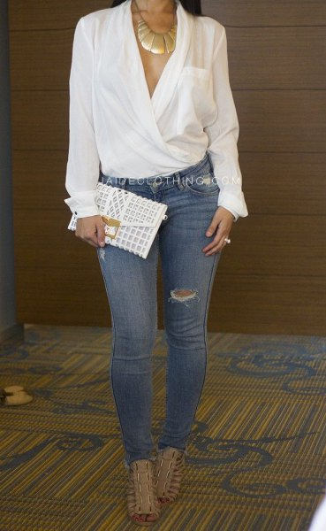 white wrap dressy blouse with blue ripped skinny jeans