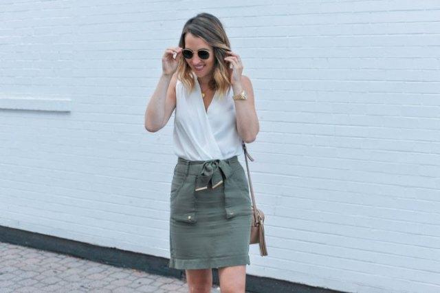 white wrap sleeveless top with grey mini skirt