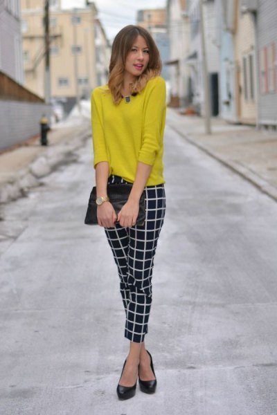 yellow pullover sweater with black and white skinny plaid pants