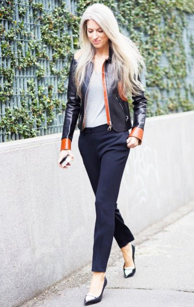 black and red leather jacket with navy blue pants