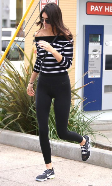black and white horizontal striped off the shoulder sweater with windbreaker tights