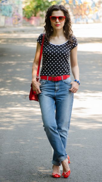 black and white polka dot tee with light blue cuffed jeans