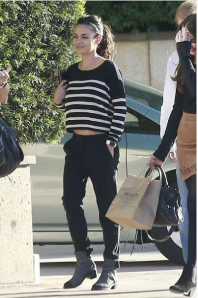 black and white striped cropped sweater with grey boots
