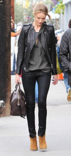 black leather biker jacket with grey button up shirt with waxed jeans