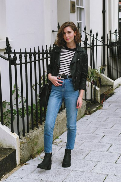 black leather blazer with striped tee and blue jeans