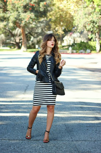 black leather jacket with striped midi dress and open toe heels