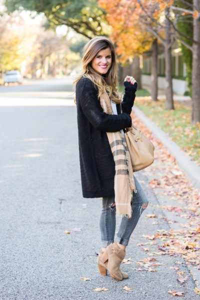 black longline cardigan sweater with striped scarf and suede boots