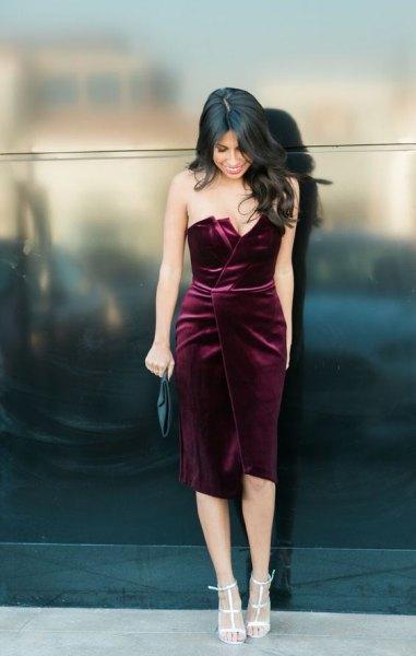 black strapless velvet wrap dress with white heels