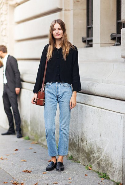 black sweater with blue jeans and leather loafers