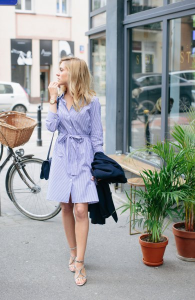 blue and white striped tie waist knee length shirt dress with strappy sandals